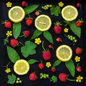 image of mint-green  - Summer fruit pattern of the fresh strawberry lemon mint leaves green currants and yellow flowers on the black background - JPG