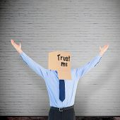 image of anonymous  - Cheering anonymous businessman against grey room - JPG