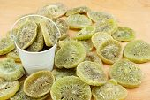 pic of bucket  - White bucket with dried kiwi on the wooden floor as a background - JPG