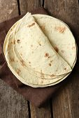 pic of whole-wheat  - Stack of homemade whole wheat flour tortilla on napkin - JPG