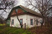 stock photo of house woods  - old white wooden house in the village - JPG