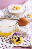foto of candy  - Making candied violet flowers with egg whites and sugar - JPG