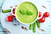 image of pea  - Tasty peas soup and vegetables on table close up - JPG