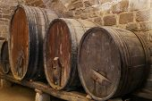 pic of basement  - four cider or wine barells in a basement - JPG