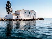 picture of greek-island  - A Greek orthodox monastery of Vlacherna on an island in shallow sea near Corfu Town connected by bridge to mainland - JPG