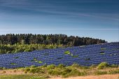 pic of solar battery  - Beautiful landscape of solar batteries in the green fields - JPG