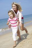 image of chase  - Mother Chasing Daughter Along Beach - JPG