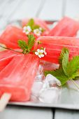 stock photo of popsicle  - Homemade rhubarb strawberry popsicles - JPG