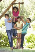 pic of 11 year old  - Group Of Children Climbing Rope Ladder To Treehouse - JPG
