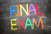 stock photo of exams  - Final Exam written on a chalkboard - JPG
