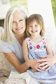 picture of granddaughter  - Portrait Of Grandmother And Granddaughter Sitting In Chair - JPG