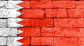 stock photo of bahrain  - Flag of Bahrain painted over on old brick wall - JPG