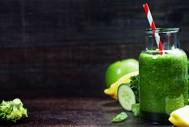 foto of cucumbers  - Fresh organic green smoothie with spinach - JPG