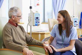 pic of chemotherapy  - Senior Man Undergoing Chemotherapy With Nurse - JPG