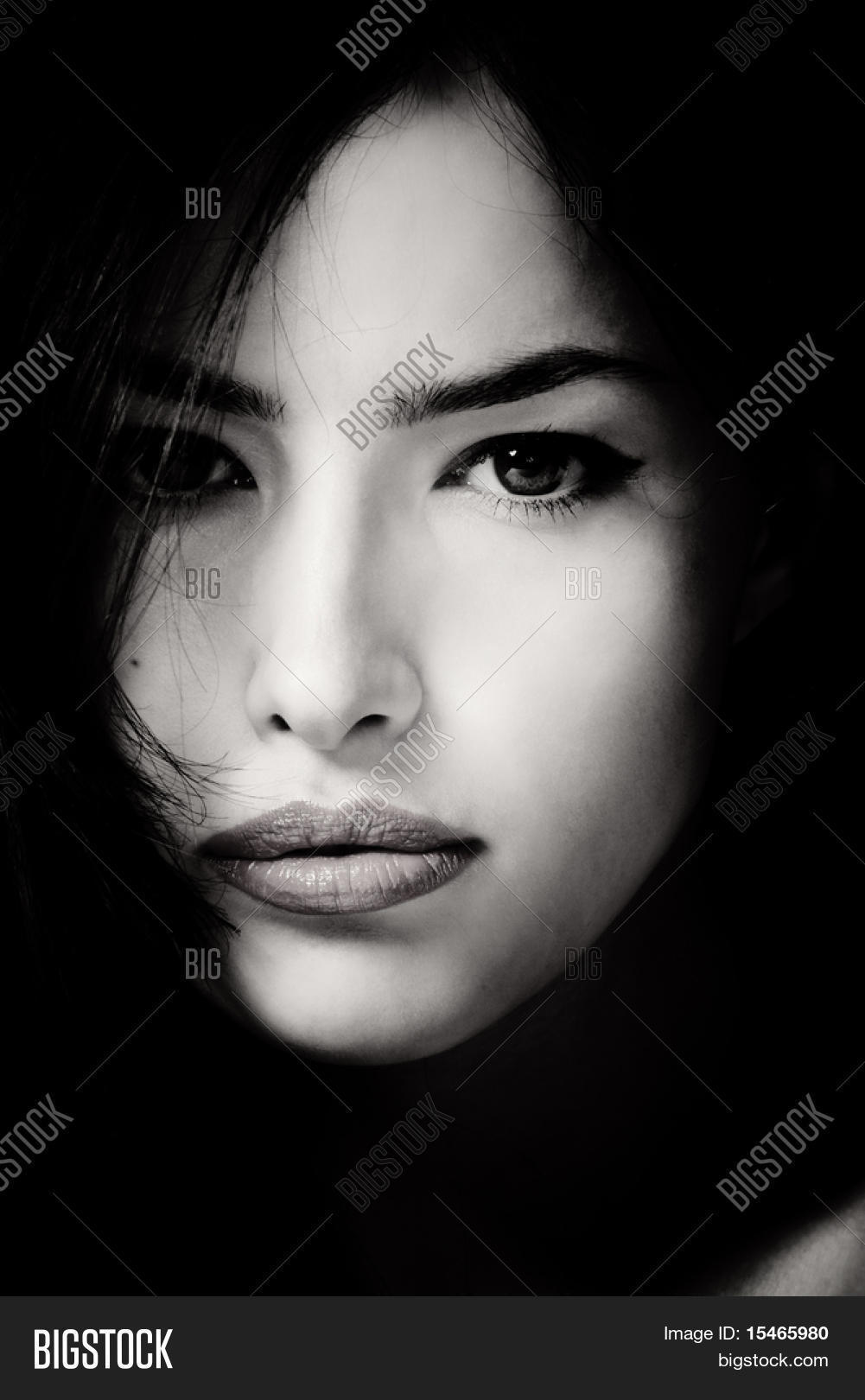 Black And White Photography Woman As Temptress : Beautiful female face in black and white stock photo