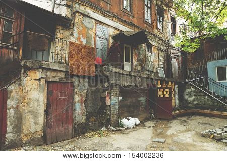 Tinted Landscape Of Destroyed Homes In A Poor Quarter For The Poor People.