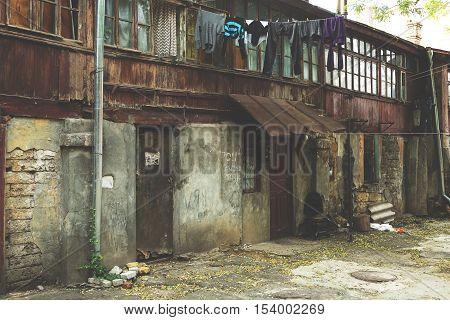 Toning Landscape Of Destroyed Homes In A Poor Quarter For The Poor People.