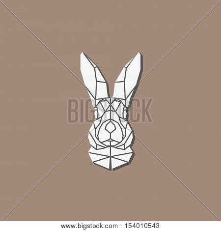 Polygonal abstract rabbit head with shadow isolated on light brown background. Portrait rabbit in geometry style. Outline emblem and badge - vector symbol.