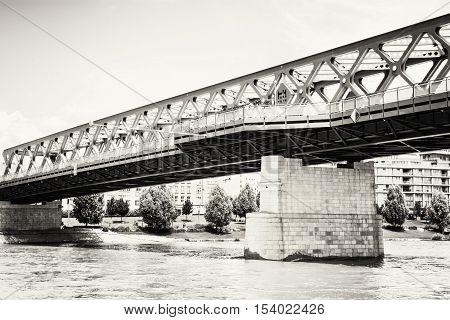 Bridge and Danube river in Bratislava Slovak republic. Architectural scene. Black and white photo. Infrastructure theme.