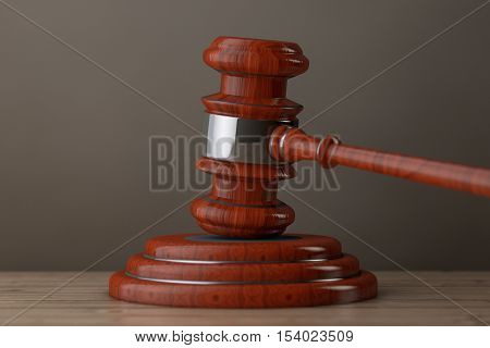 Judge Gavel and Sound Block on a wooden table. 3d Rendering