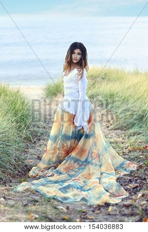 young girl at beach with flower dress