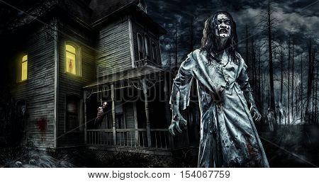 Horror zombie near the abandoned house. Halloween.