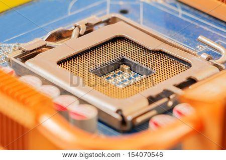 Empty CPU socket on motherboard. Selective focus.