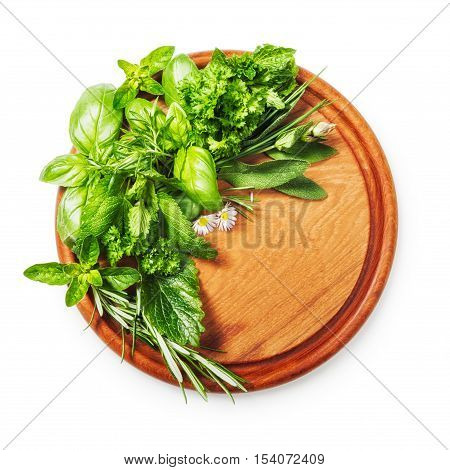 Herbs on cutting board. Fresh basil parsley sage peppermint and rosemary bunch. Single object isolated on white background clipping path included. Top view flat lay