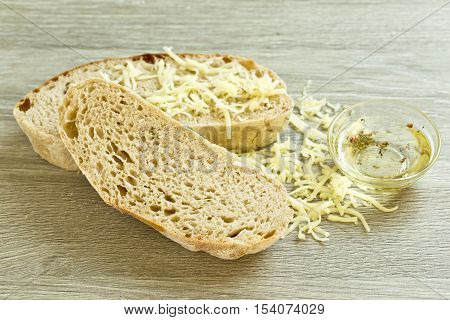 slices of tasty ciabatta bread and  olive oil with grated cheese and mixed peppers