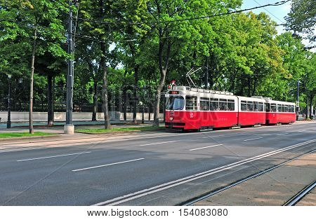 VIENNA AUSTRIA - JUNE 6: Red classic tram goes by Ringstrasse street Vienna on June 6 2016. Vienna is a capital and largest city of Austria.