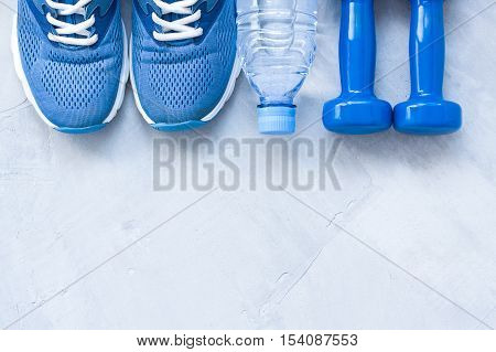 Flat Lay Sport Shoes, Bottle Of Water And Dumbbells