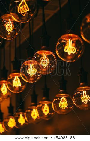 Group of lamps with interesting shape of tungsten filament. Modern lighting of cafe and restaurant.