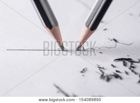 Mistake concept Close up of a sharpened pencil writing a straight line