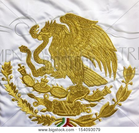 GUANAJUATO, MEXICO - DECEMBER 31, 2014 Mexican Symbol on flag in Independence Museum Alhondiga de Granaditas Guanajuato Mexico. Granary was site of important battle in 1810 Mexican War of Independence. Symbol of Mexico on Its Flag. Ealge on Cactus with Sn