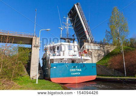 Cargo Ship Comes To The Narrow Gateway