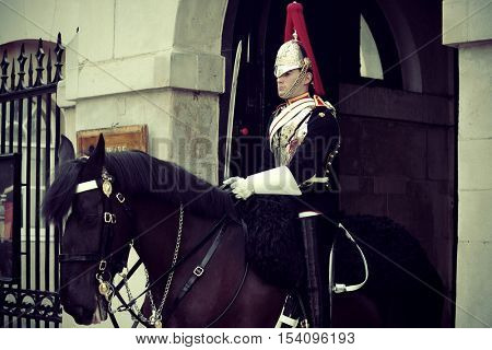 LONDON, UK - SEP 27: Trooper of the Blues and Royals on horse at the horse guard parade on September 27, 2013 in London, UK. Blues and Royals is one of two most senior regiments of the British Army