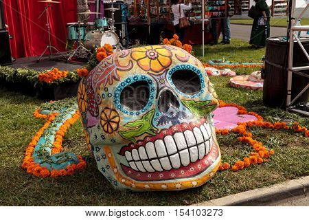 Los Angeles, CA, USA - October 29, 2016: Flower and skeleton alter at Dia de los Muertos, Day of the dead, in Los Angeles at the Hollywood Forever Cemetery grounds. Editorial use only.