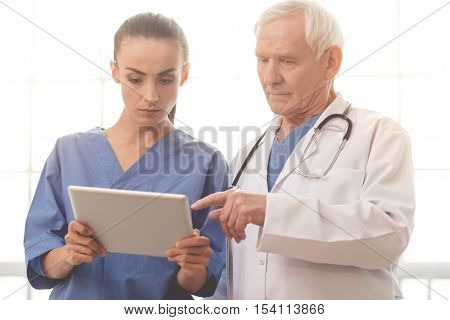 Old And Young Doctors