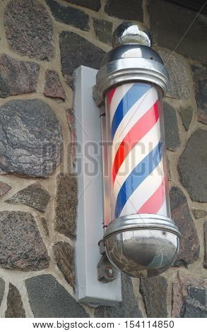 barber shop pole red blue and white strip sign