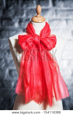 Mannequin with silk cloth. Knitted fashion red organza shawl on tailor bust. Single object with clipping path
