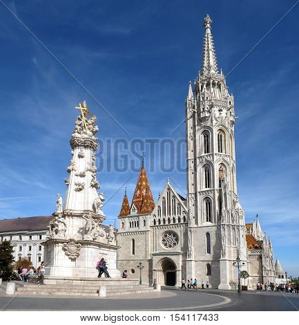 BUDAPEST HUNGARY - SEPTEMBER 29 2016: Matthias Church and the Trinity plague column in the Buda castle in Budapest