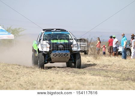 Speeding Green And White Toyota Hilux Twin Cab Rally Car Front View