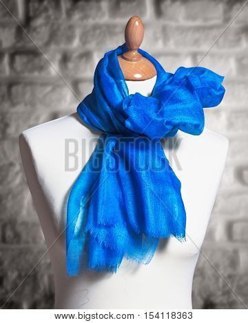 Mannequin with silk cloth. Knitted fashion blue organza shawl on tailor bust