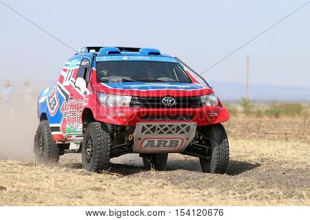 Close-up View Of Speeding Red And Blue Toyota Hilux Twin Cab Rally Car