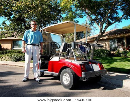 Senior Golfer And Golf Cart