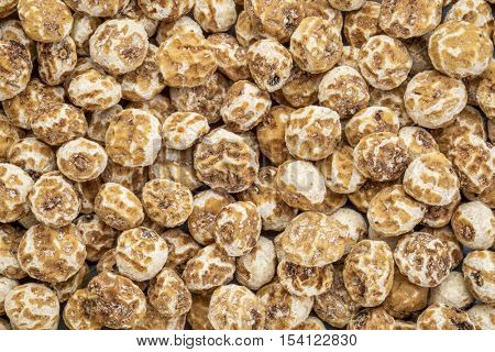 organic peeled tiger nuts, a rich source of resistant starch, top view background