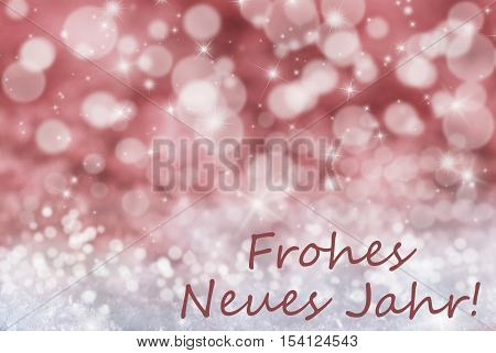 German Text Frohes Neues Jahr Means Happy New Year. Sparkling Red Bokeh Christmas Background Or Texture With Snow And Stars. Copy Space For Your Text Here