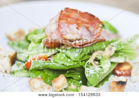 Caesar salad or salad with cos lettuce and ham