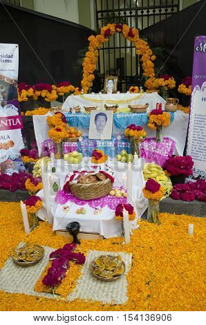 XALAPA, VERACRUZ,MEXICO- OCTOBER 28, 2016: Traditional mexican day of the dead offering altar with flowers and food in Xalapa, Veracruz, Mexico