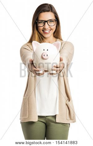 Beautiful and happy woman holding a piggy bank, isolated over white background